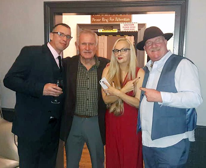 Andrew Parkin (left) and retired prison guard Mick O & # Hagan (2nd L) attends the wedding reception of Charles Bronson