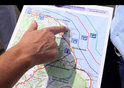 French maritime gendarmes examine map of area where search for MH370 is taking place - August, 2015.