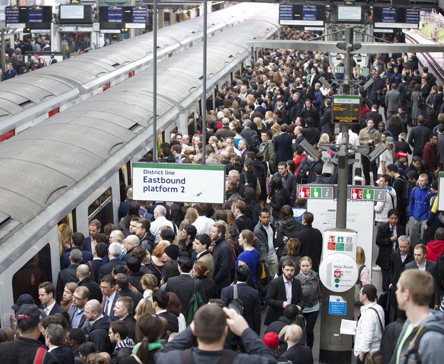Commuters try to get on a train on the District Line of the London Underground during the 48-hour tube strike at London's Earl's Court tube station in England on April 29, 2014