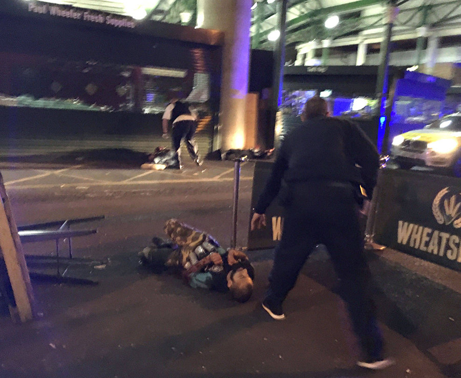 3rd June, London Bridge: an attacker wearing a fake suicide vest lies on the ground after being shot by police