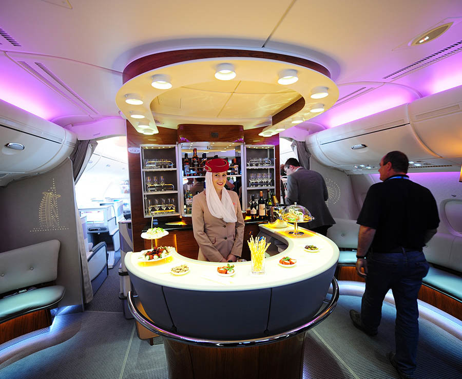 A stewardess poses in the bar of an Emirates Airlines A380