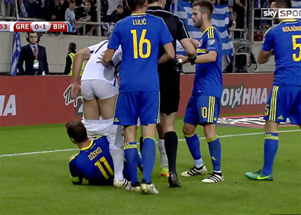 Image result for Dzeko sent off for pulling down players shorts
