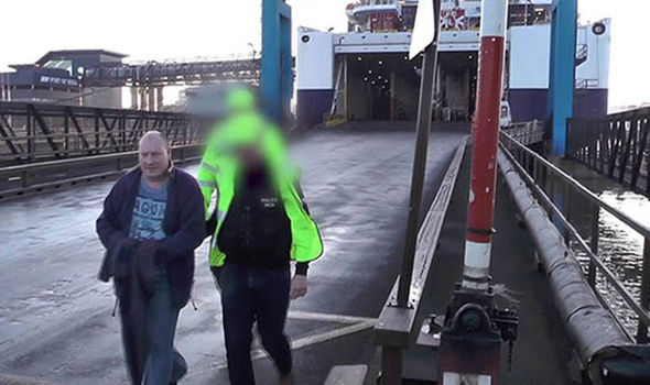 Eddie Tron being arrested from the ferry
