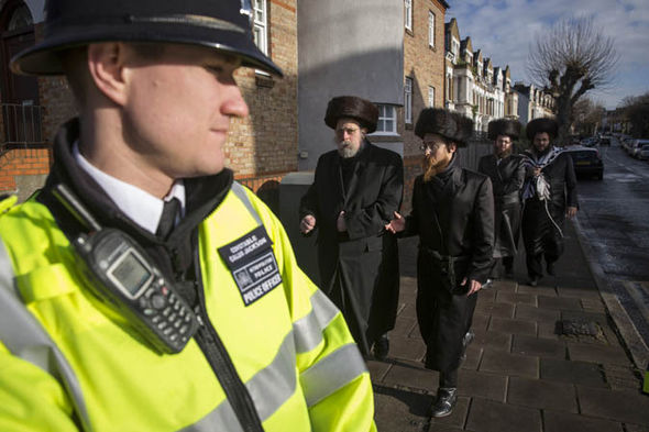 A policeman with Orthodox Jews