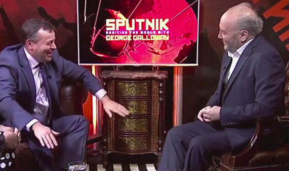 Arron Banks with George Galloway during an interview for RT