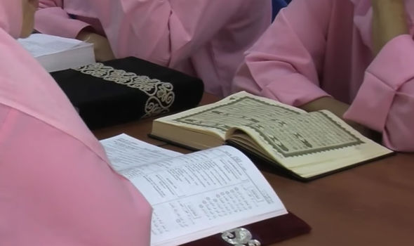 Women read books in Dubai prison