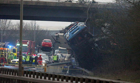 Police on the A12 as lorry hangs over bridge