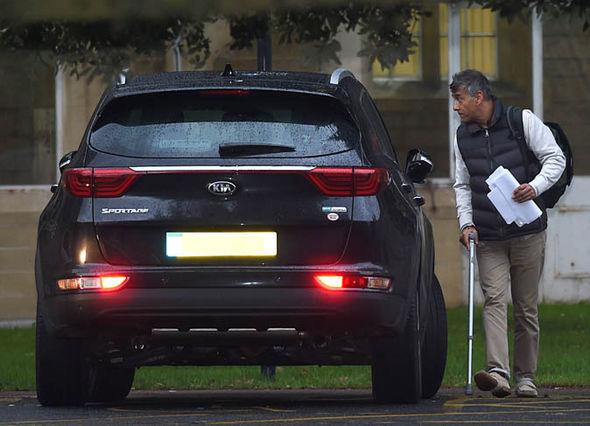 John De'Viana coming out of car