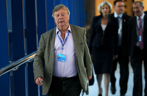 Kenneth Clarke walks ahead of PM May