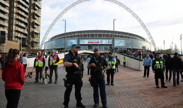 Armed police officers are on the scene at Wembley
