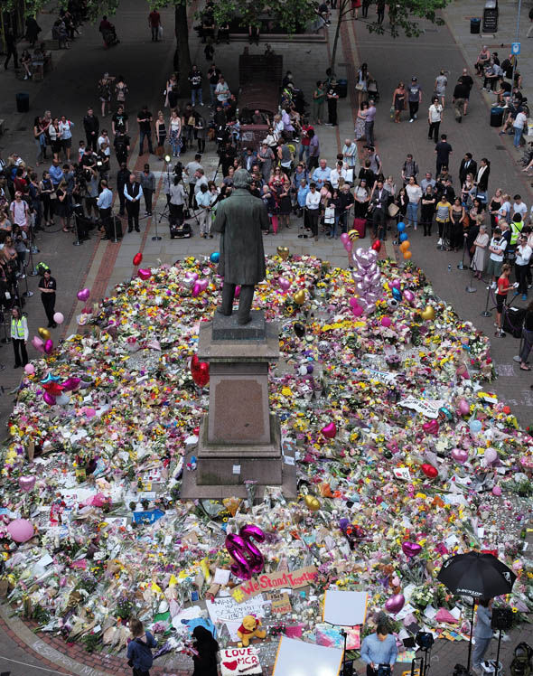 Mourners pay tribute to those killed in the Manchester attack