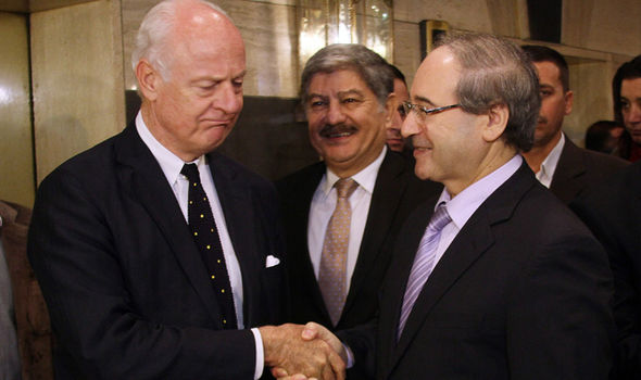Mr Faisal (R) has been in Assad's government for over a decade