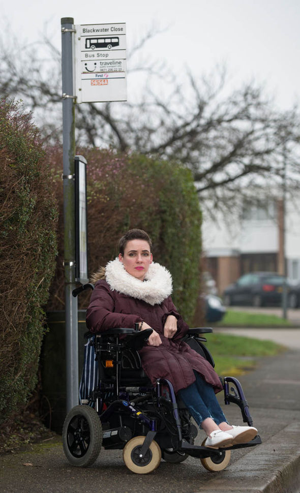 Nicki Price sits by the bustop