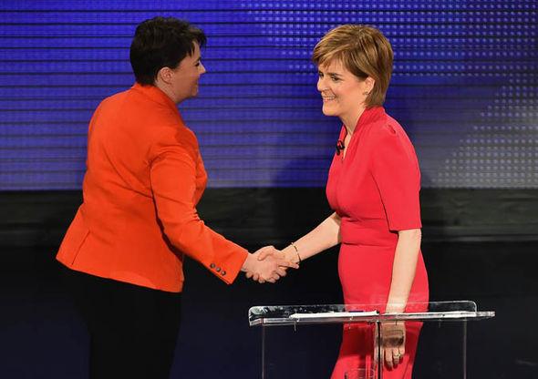 Nicola Sturgeon shakes Ruth Davidson's hand