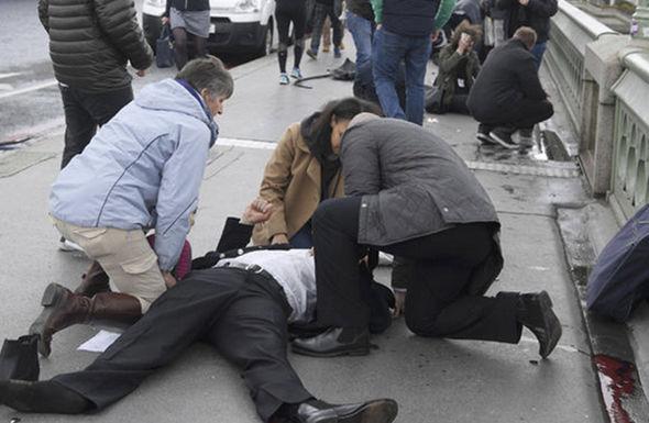 People help a bleeding man on Westminster bridge