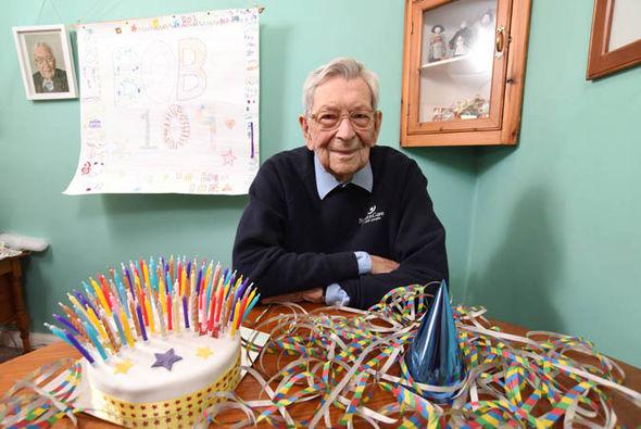 Robert Weighton next to his 109th birthday cake