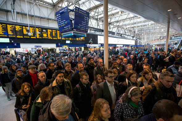 Crowds of people wait for a southern train