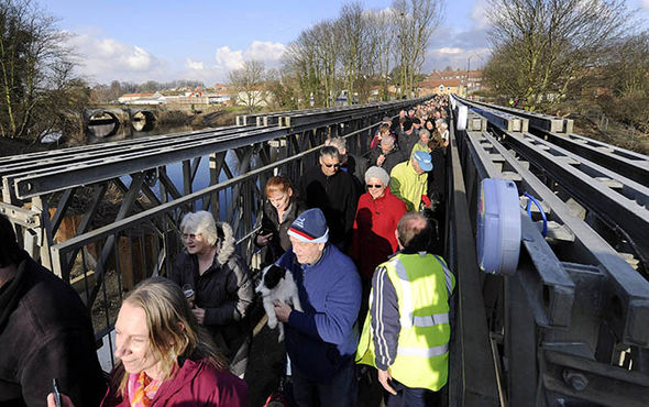 People on Tadcaster bridge