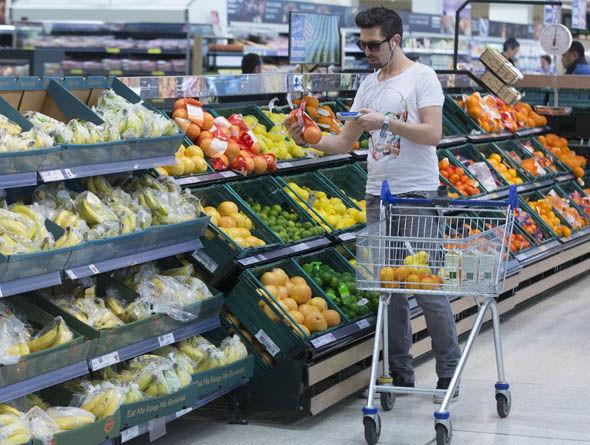 Tesco shopper in the fruit and veg aisle