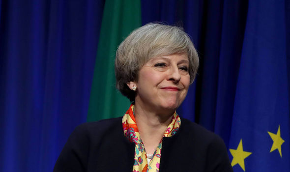 Theresa May smiling