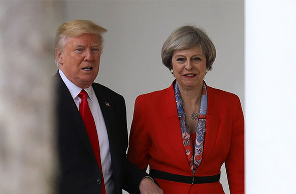Theresa May first warned Trump about Russia