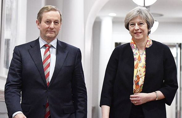 Theresa May walks with Enda Kenny