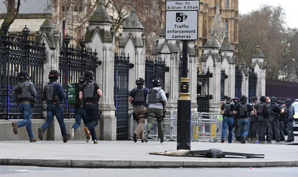 Armed police rushed towards Westminster