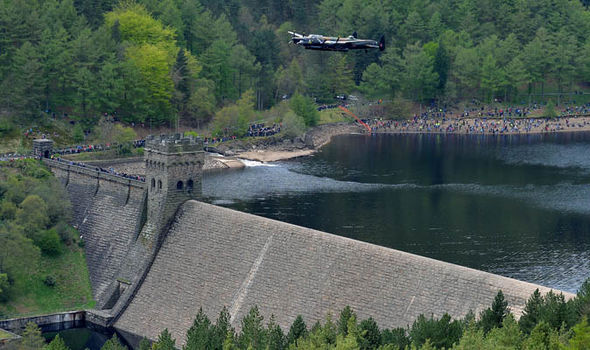 A Lancaster bomber flies over Derwent