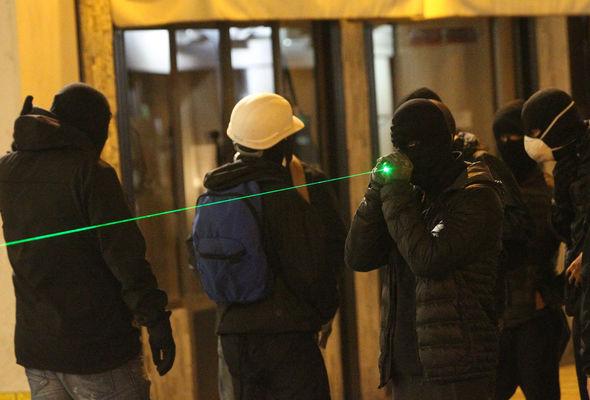 People shining laser pens