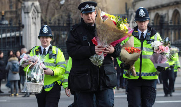 Police lay flowers at House of Parliament