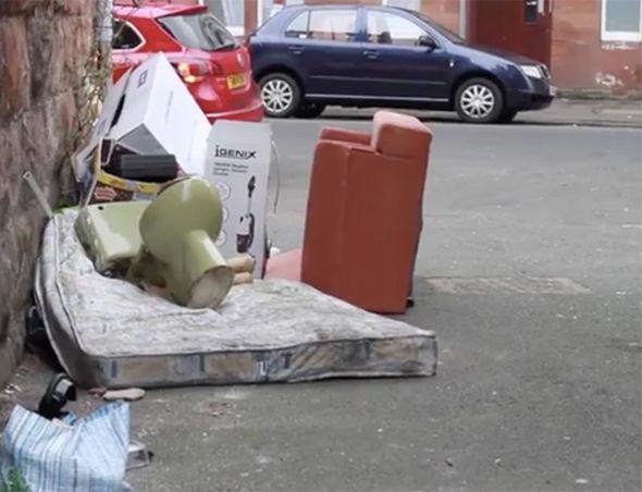 Rubbish is filmed strewn across the floor