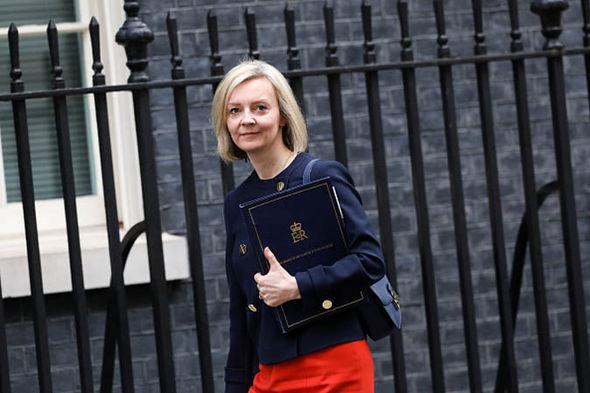 Liz Truss holding a briefcase
