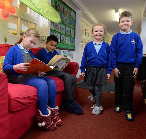 Children reading in slippers