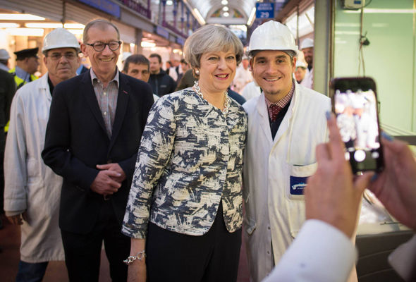 Theresa May posed for photos as her husband Philip joined the campaign trail