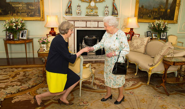 Theresa May meets the Queen