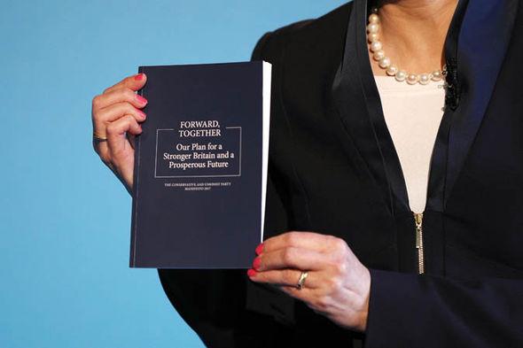 Theresa May with Tory manifesto