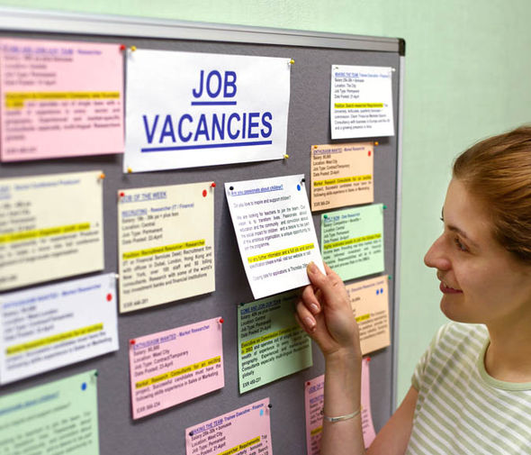 Woman looking at vacancies board