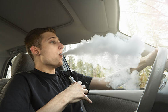 Guy vaping in a car
