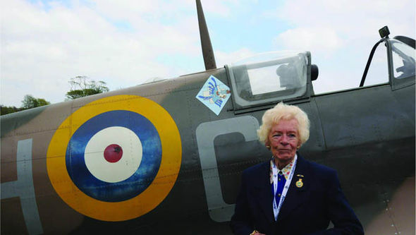Mary Ellis with a Spitfire
