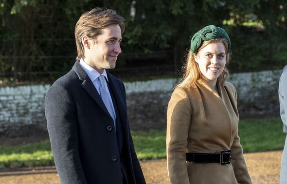 Princess Beatrice and Mr. Mozzi standing