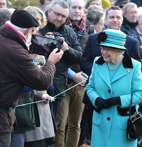Her Majesty is all smiles as she greets crowds