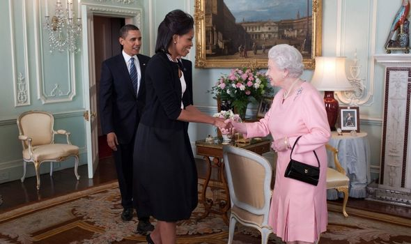 Michelle Obama meeting the Queen alongside Barack Obama