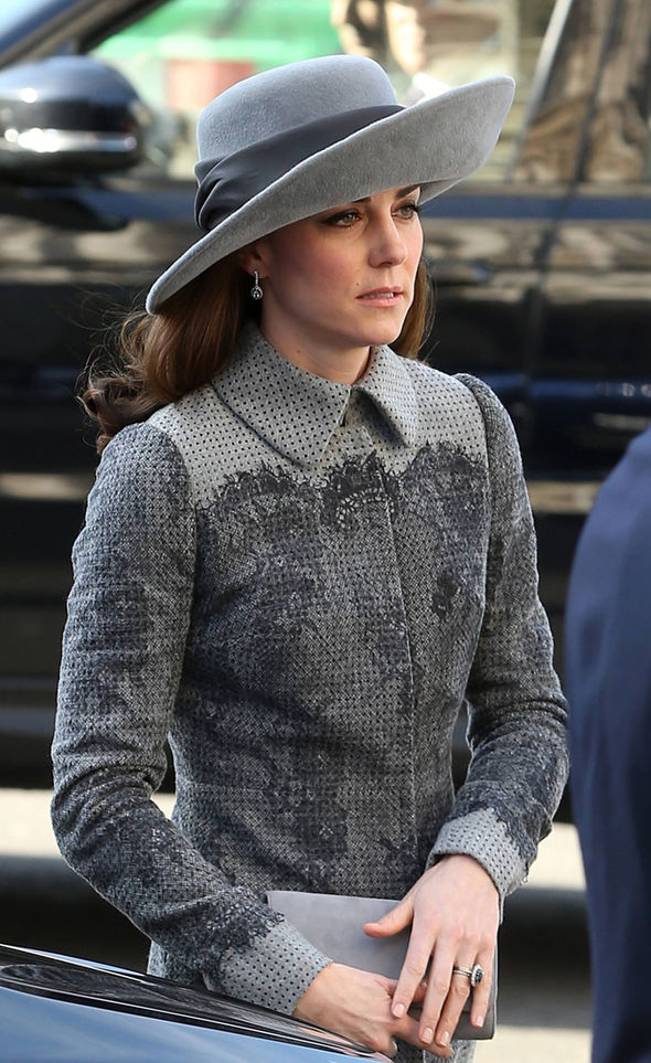 Woman in grey coat and hat