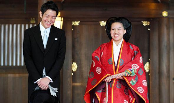 Princess Ayako of Takamado and Kei Moriya speak to media reporters after their wedding