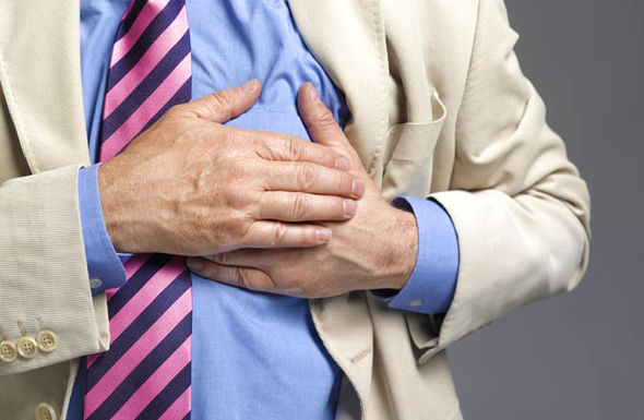 Man clutching heart   Walking for less than 30 minutes each day can make you live longer | Health | Life & Style heart 1100286
