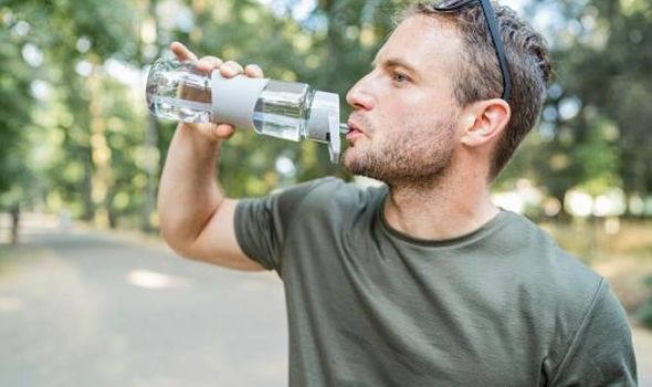 Does hot weather affect blood pressure?: Man drinking water