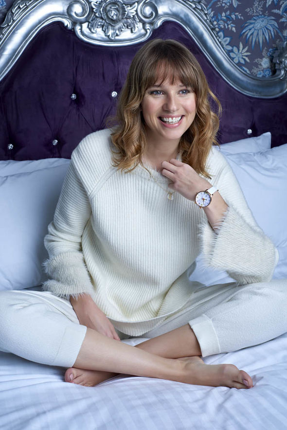 model in white cashmere sitting on bed  Loungewear sets from Mint Velvet, Debenhams | Style | Life & Style cashmere sweater cashmere trousers loungewear 1191066