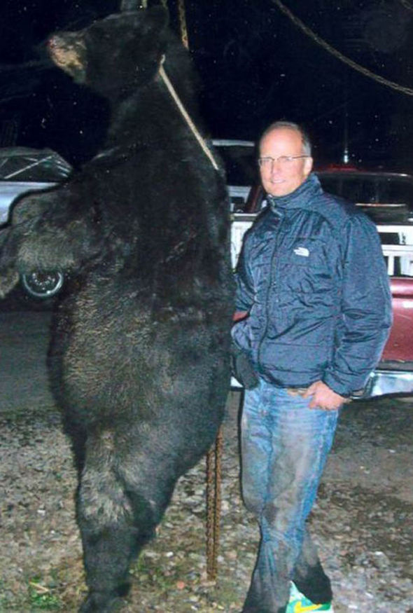 Man with dead bear