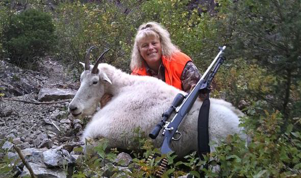 Michelle Slyder with a dead wild goat