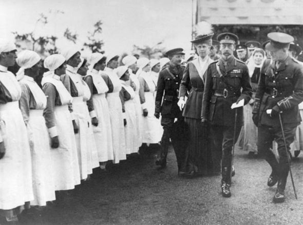 King George V and Queen Mary with others, visiting a hospital during the First World War